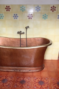 Bathroom with copper bath